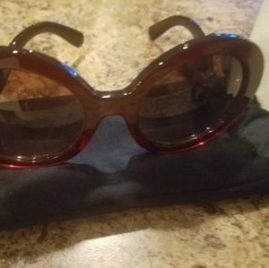 PRADA red sunglasses Brand new. With case and sack